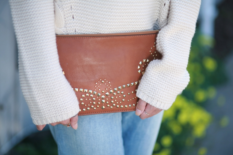 Boho vibes. This clutch is by Michael Kors.